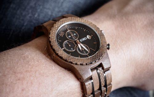 Wooden JORD Conway watch worn against dark blue jeans