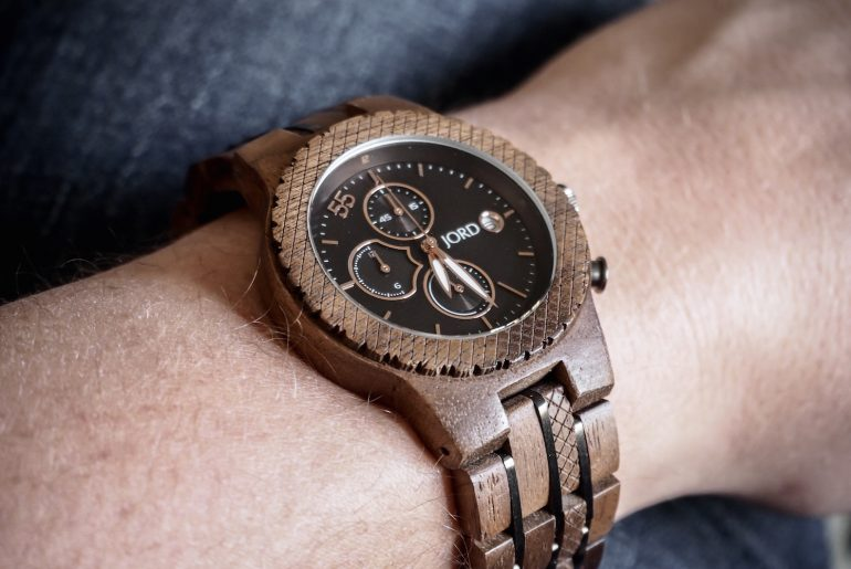 Wooden JORD Conway watch worn against dark blue jeans